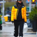 Emily Ratajkowski in a Yellow Puffer Jacket Walks Her Dog Out with Her Husband in Manhattan, New York 01/27/2021