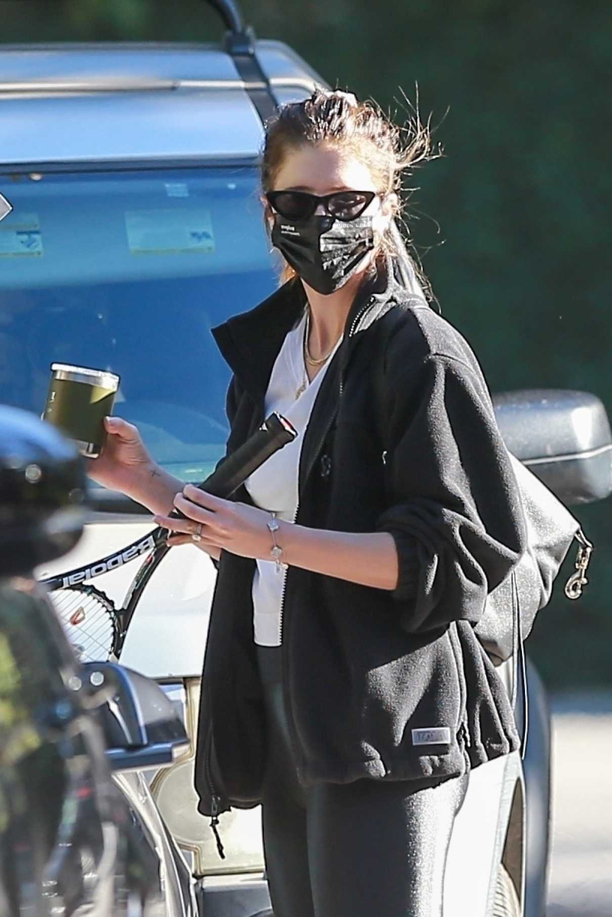 Katherine Schwarzenegger in a Black Protective Mask