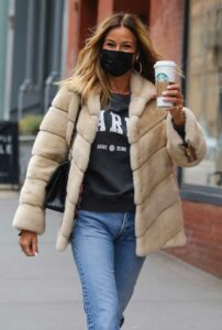 Kelly Bensimon in a Black Protective Mask