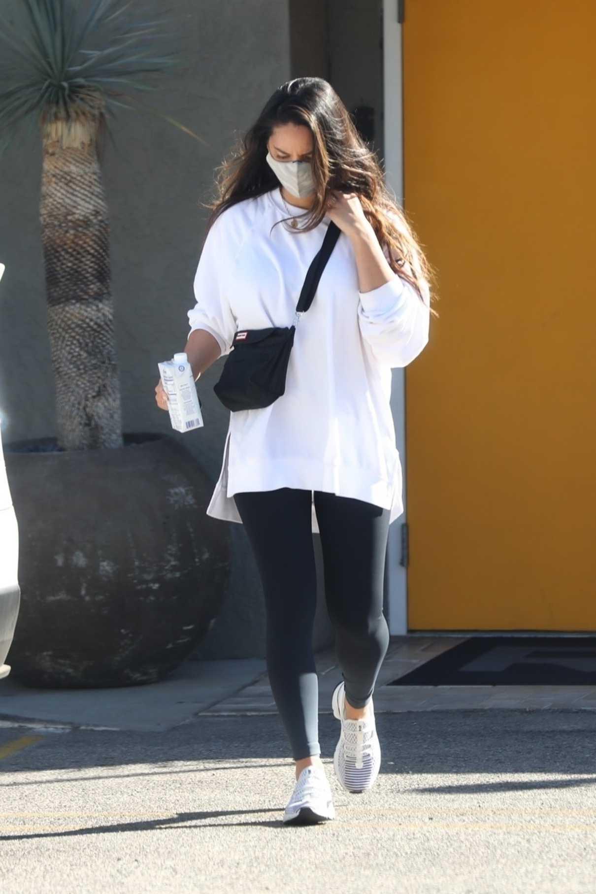 Olivia Munn in a White Sweatshirt