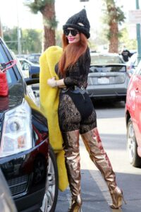 Phoebe Price in a Black Knit Hat
