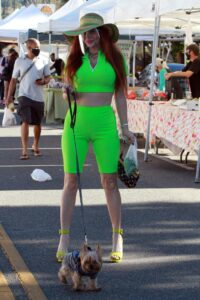Phoebe Price in a Neon Green Outfit