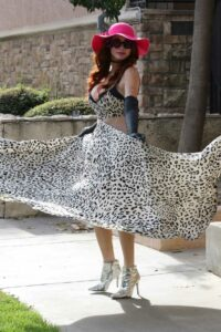 Phoebe Price in a White Animal Print Dress