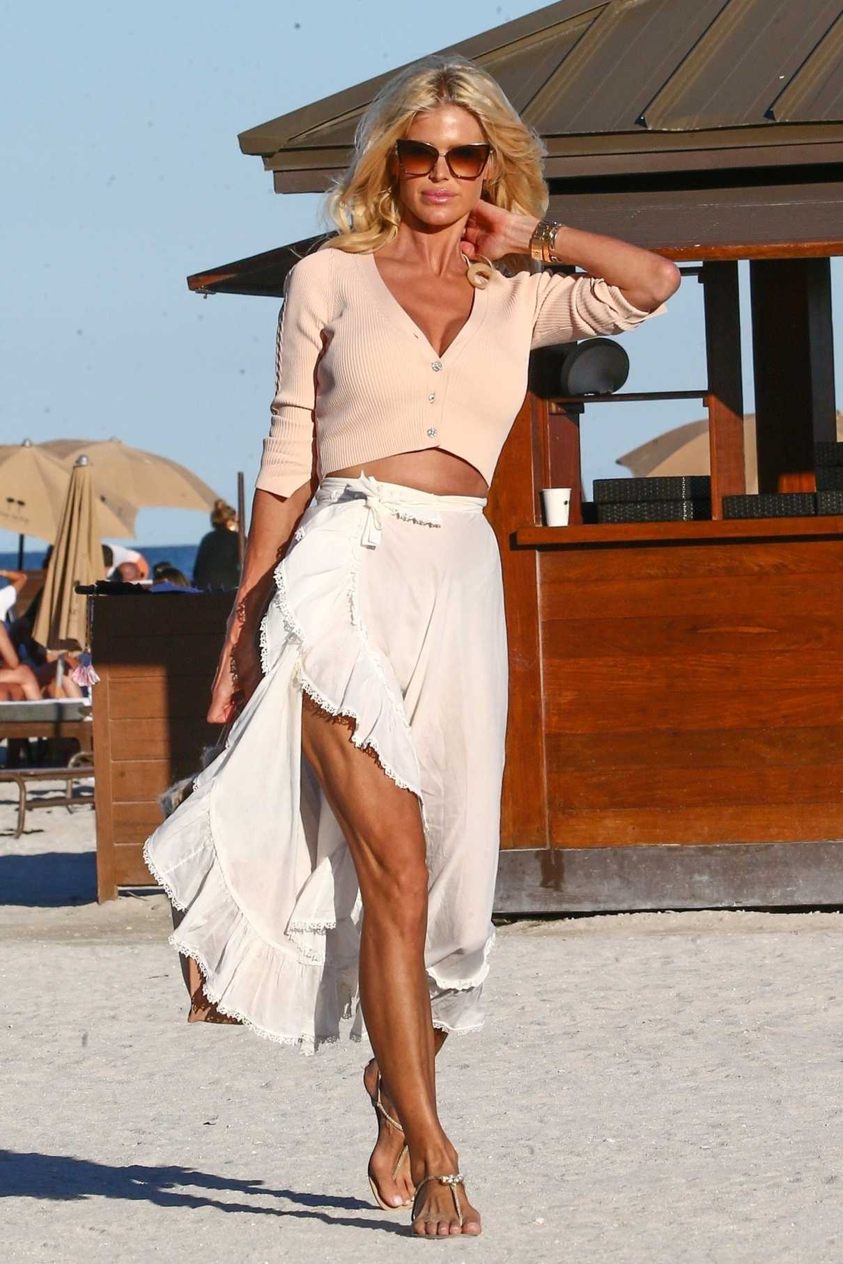 Victoria Silvstedt in a White Skirt