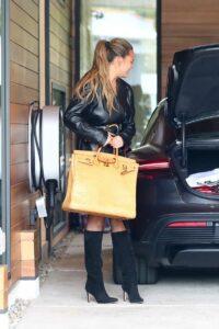 Chrissy Teigen in a Black Leather Blazer