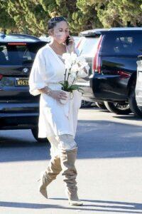 Chrissy Teigen in a White Dress