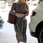 Hilary Duff in a Grey Dress Arrives at LAX Airport in Los Angeles 02/12/2021