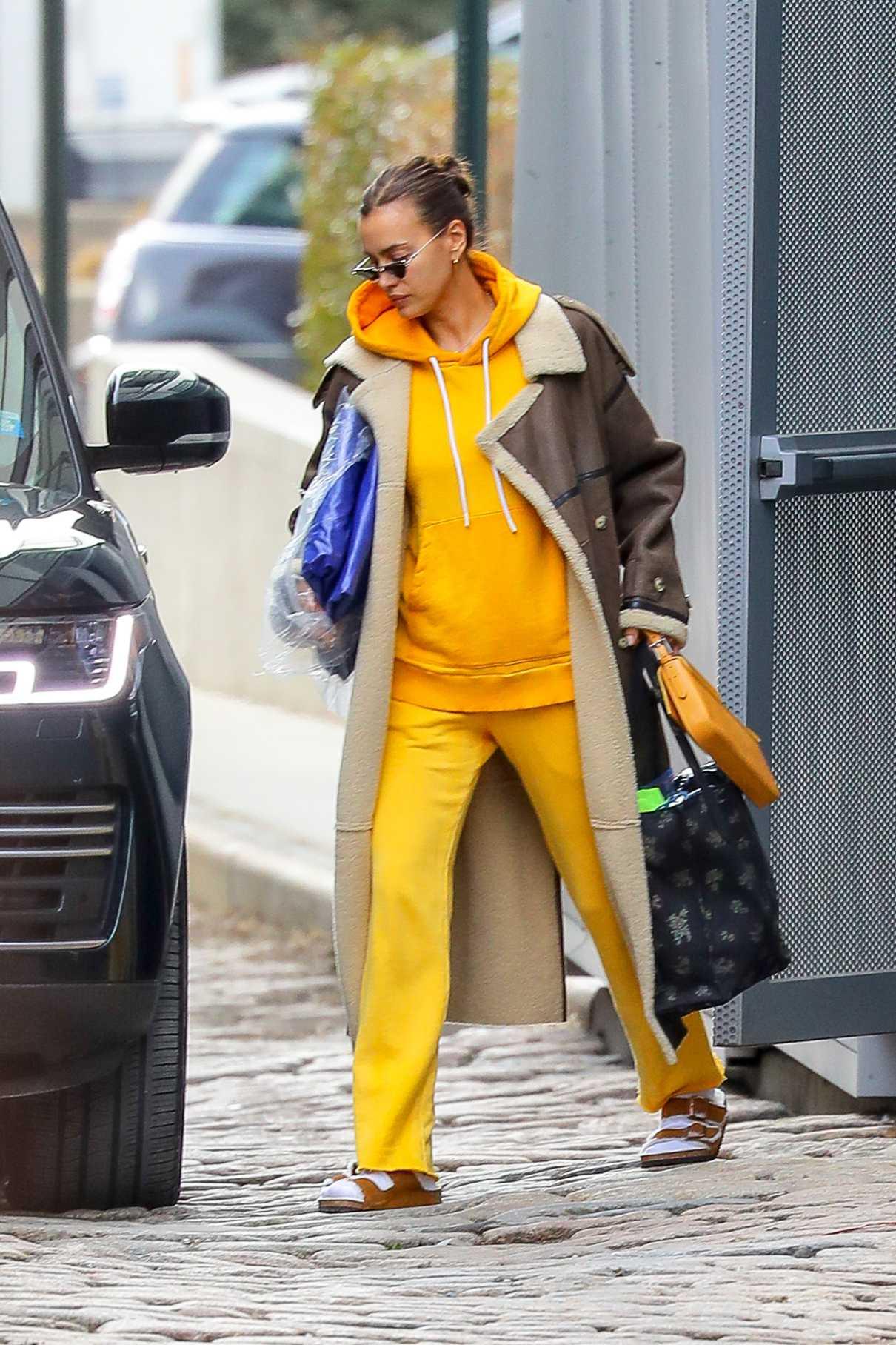 Irina Shayk in a Yellow Sweatsuit