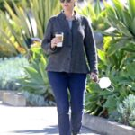 Jane Lynch in a Black Cap Gets Coffee to Go During a Leisurely Stroll in Los Angeles 02/20/2021