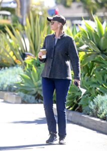 Jane Lynch in a Black Cap