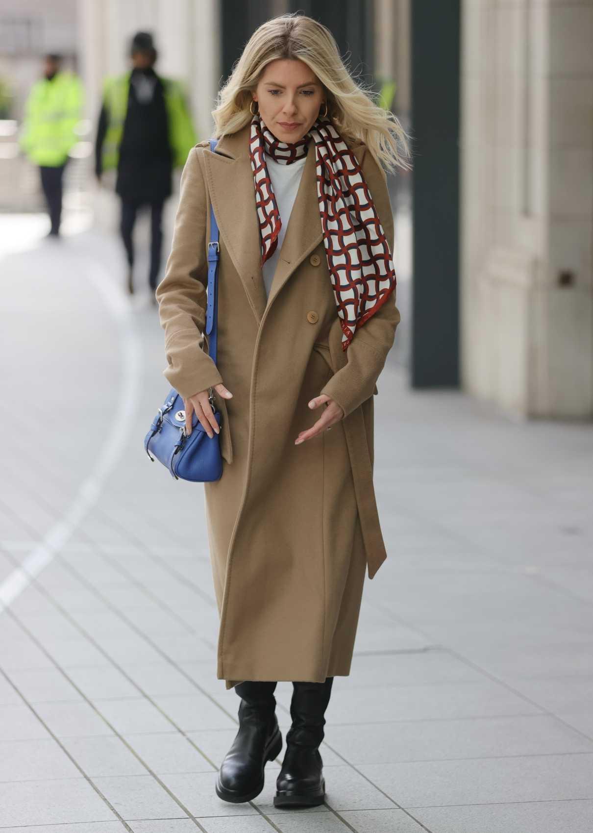 Mollie King in a Beige Coat