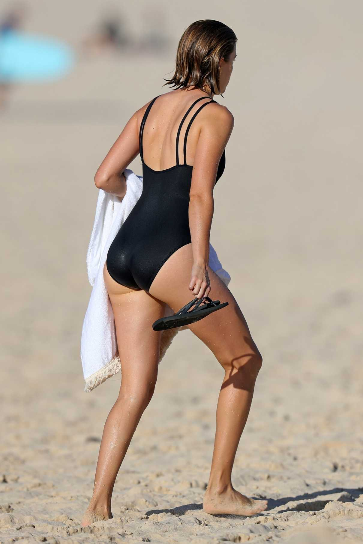 Victoria Lee in a Black Swimsuit