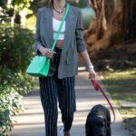 Alessandra Ambrosio in a Black Knit Hat Walks Her Puppy in Santa Monica 03/24/2021