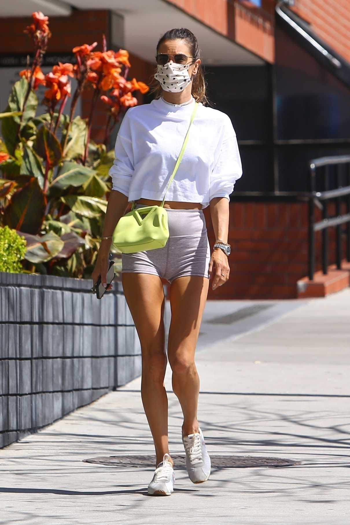 Alessandra Ambrosio in a Grey Spandex Shorts