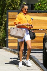 Alessandra Ambrosio in a Yellow Hoodie