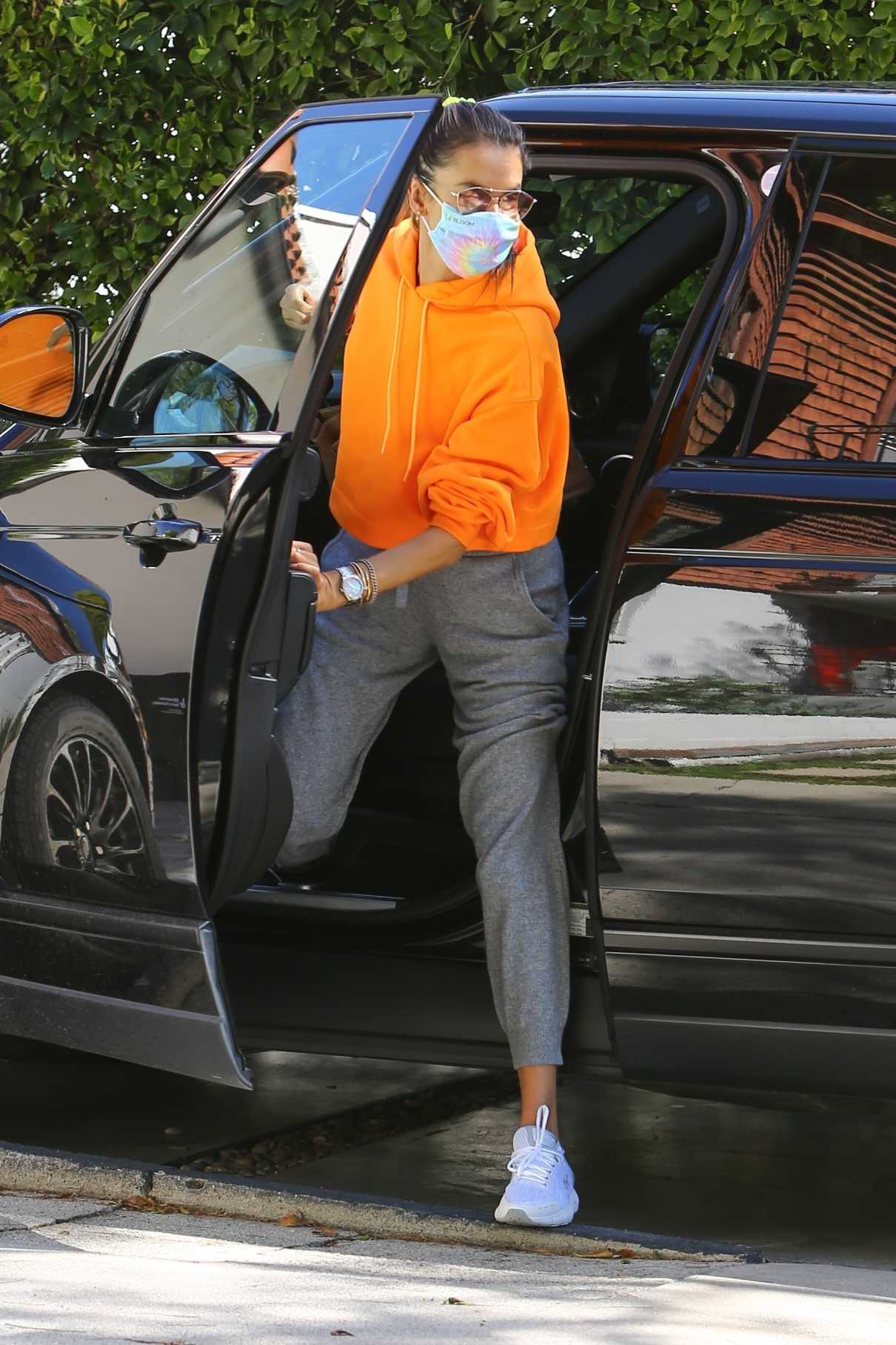 Alessandra Ambrosio in an Orange Hoodie