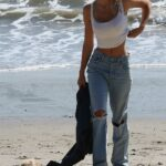 Alexis Ren in a White Tank Top Was Spotted with Her New Puppy on the Beach in Malibu 03/01/2021