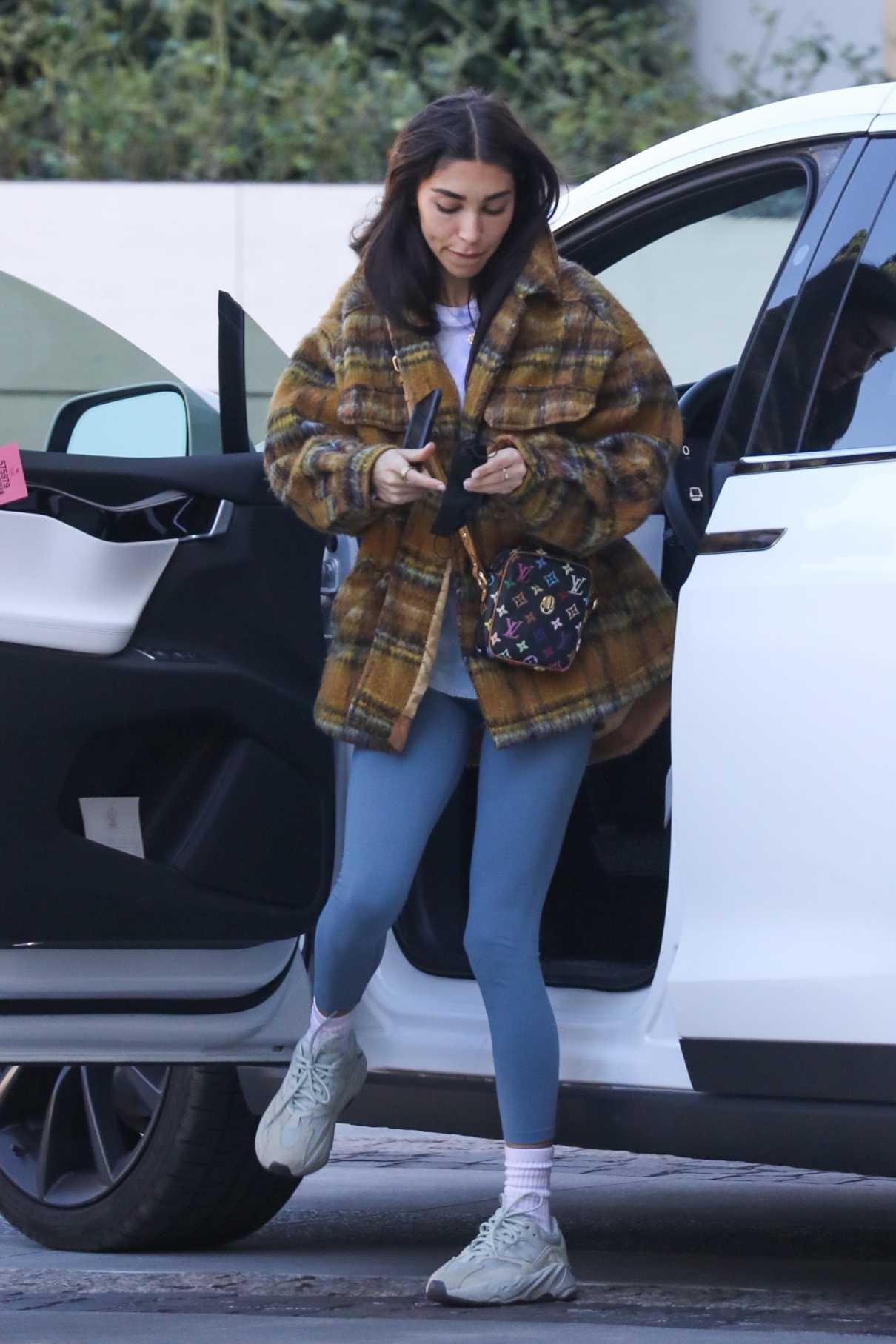 Chantel Jeffries in a Tan Plaid Jacket