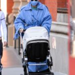 Gigi Hadid in a Blue Trench Coat Was Seen Out for a Walk with Her Daughter Khai in New York City 03/20/2021