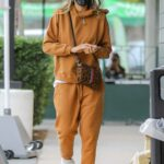 Jessica Alba in an Orange Sweatsuit Goes Shopping in Beverly Hills 03/07/2021