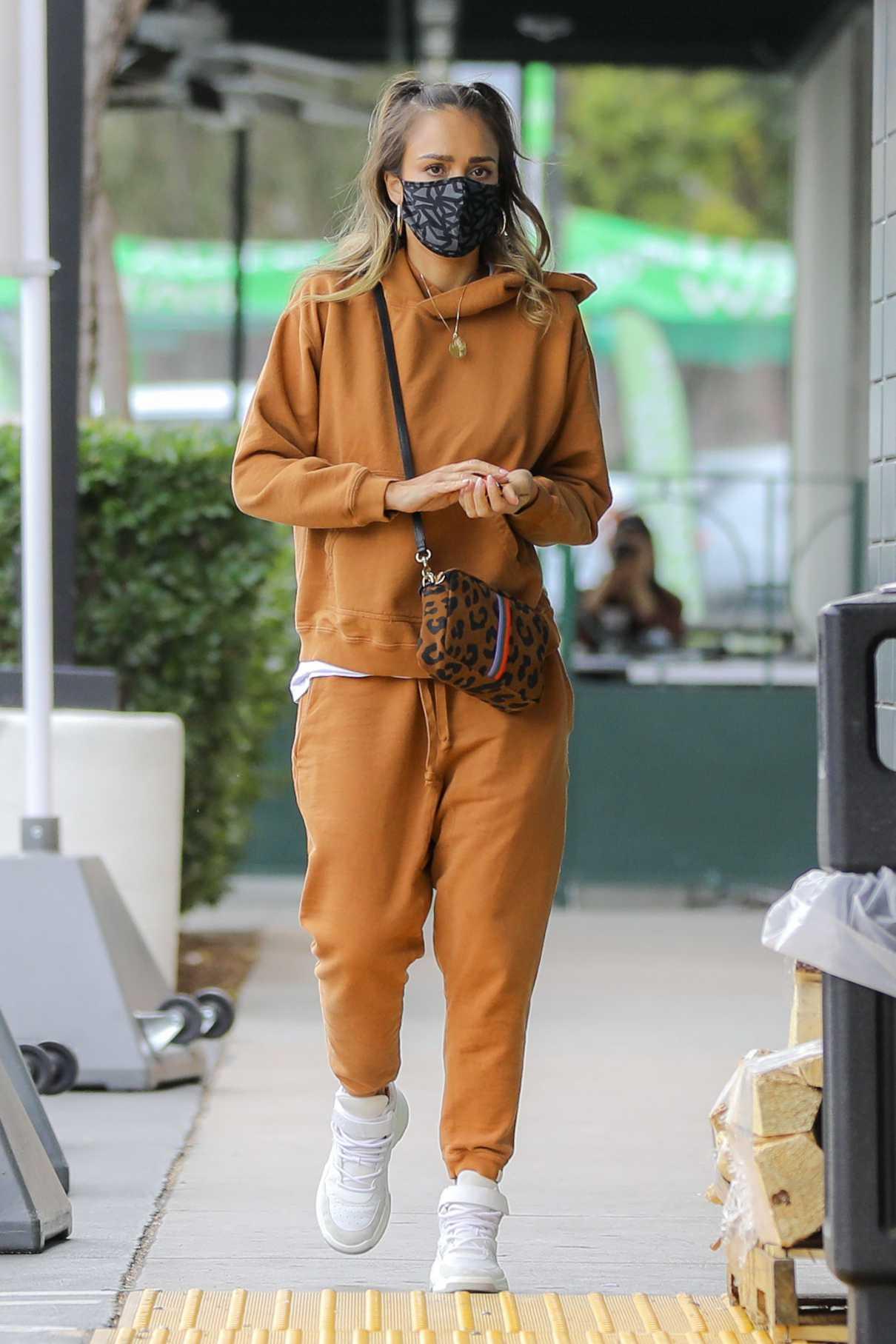 Jessica Alba in an Orange Sweatsuit