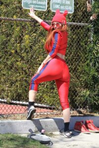 Phoebe Price in a Red Workout Ensemble