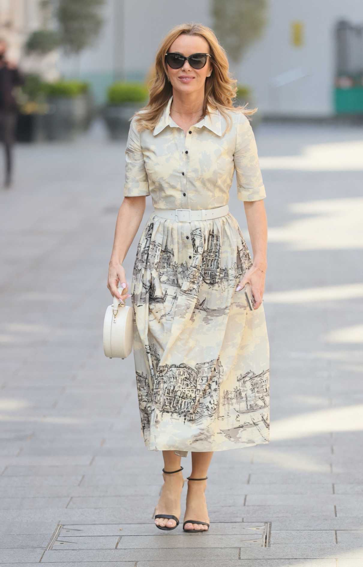 Amanda Holden in a Belted Dress