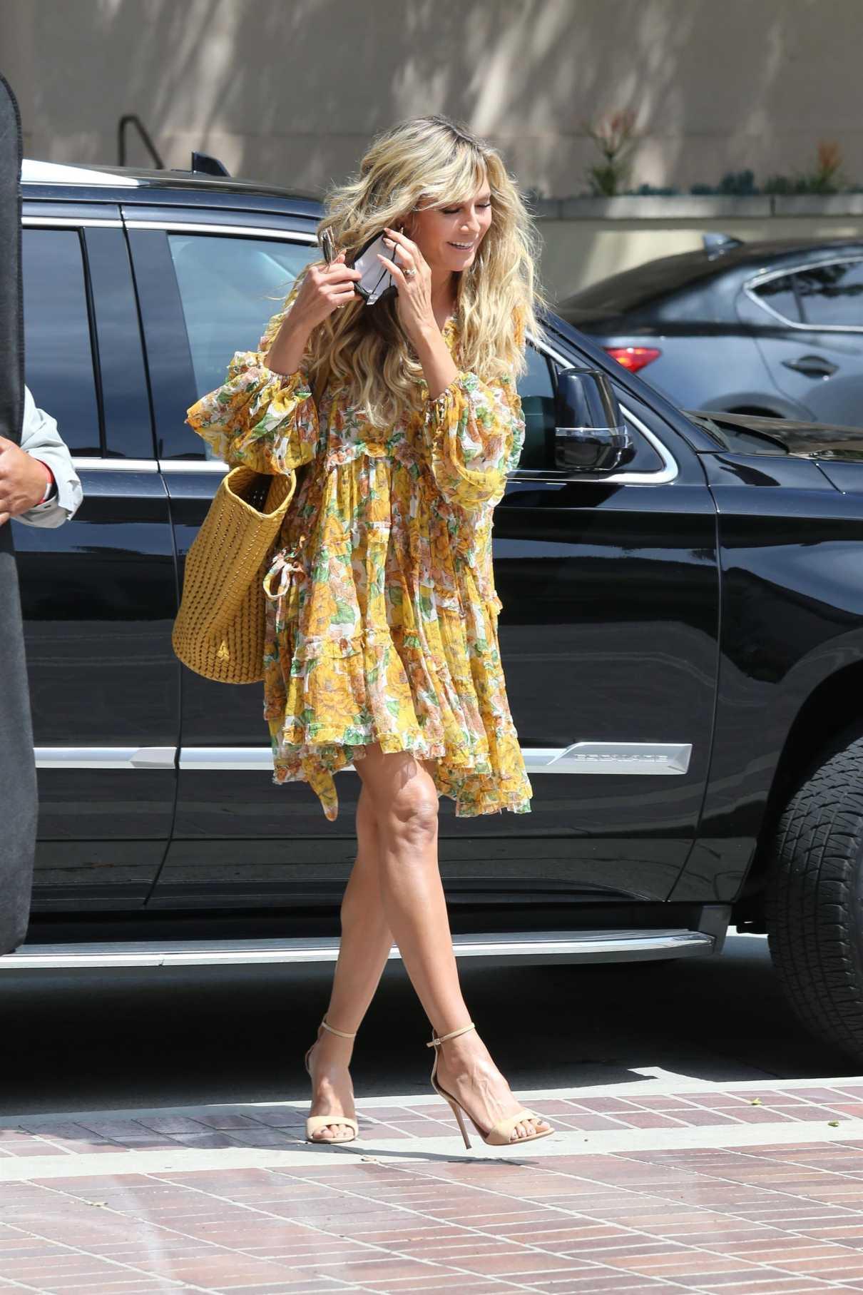Heidi Klum in a Yellow Floral Dress