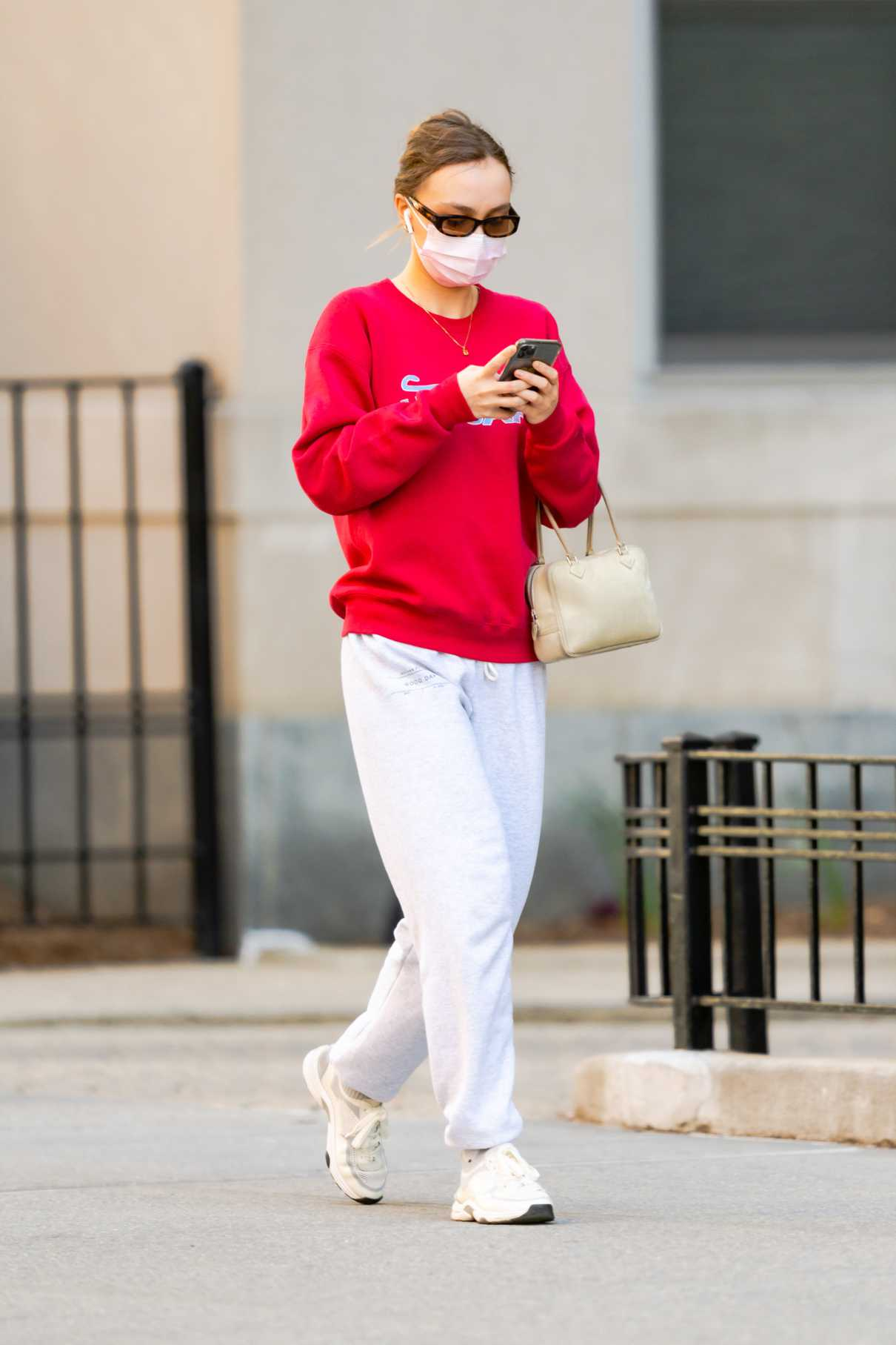 Lily-Rose Depp in a Red Sweatshirt