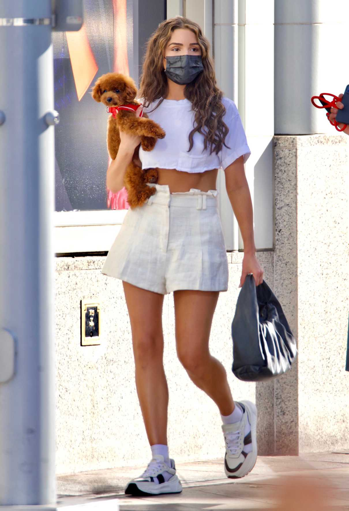 Olivia Culpo in a White Cropped Tee