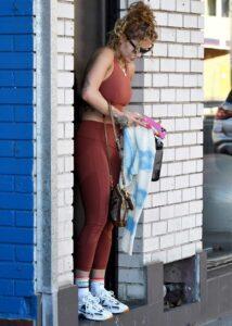 Rita Ora in a Red Workout Ensemble