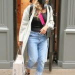 Sarah Jessica Parker in a White Coat Leaves Her SJP Collection Shoe Store in New York 04/11/2021