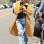 Chrissy Teigen in a Yellow Cardigan Leaves a Business Meeting in Los Angeles 05/28/2021
