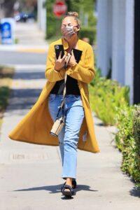 Chrissy Teigen in a Yellow Cardigan