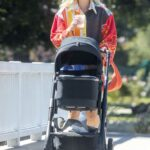 Elsa Hosk in a Colorful Cardigan Was Seen During a Coffee Run with Her Daughter in Los Angeles 04/29/2021