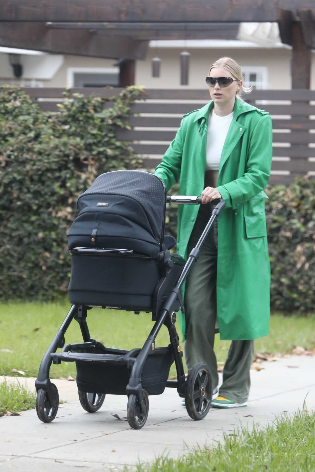 Elsa Hosk in a Green Trench Coat