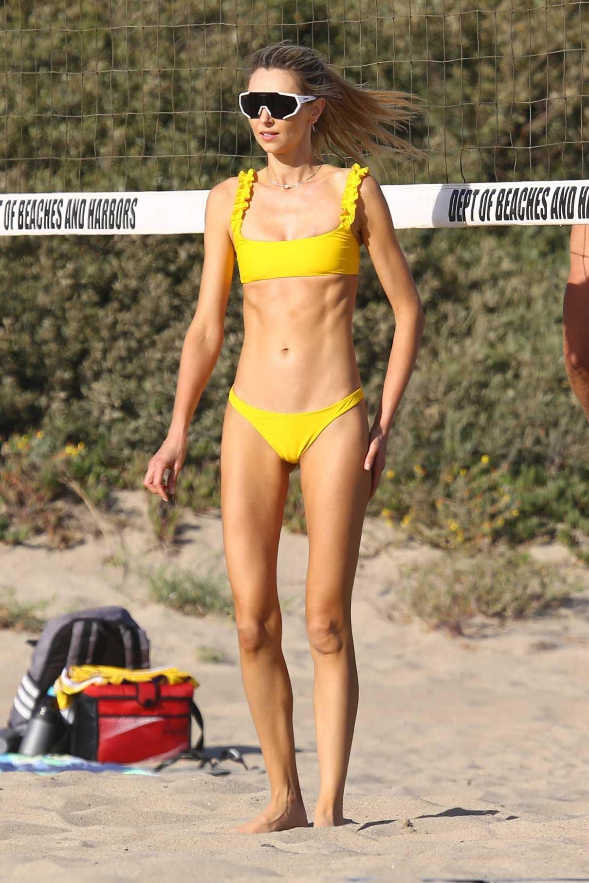Ludi Delfino in a Yellow Bikini
