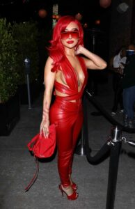 Nikita Dragun in a Red Leather Jumpsuit