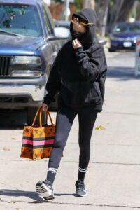 Zoey Deutch in a Black Hoodie
