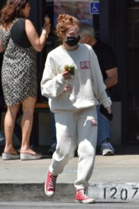 Zoey Deutch in a White Sweatsuit