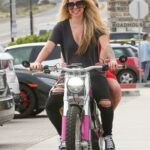 Avril Lavigne in a Black Ripped Jeans Takes Her Friend for an Electric Motorcycle Ride in Malibu 05/31/2021