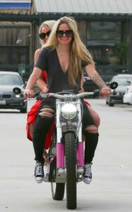 Avril Lavigne in a Black Ripped Jeans