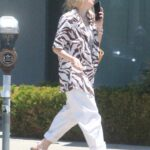 Dakota Fanning in a White Pants Was Seen Out in West Hollywood 06/08/2021