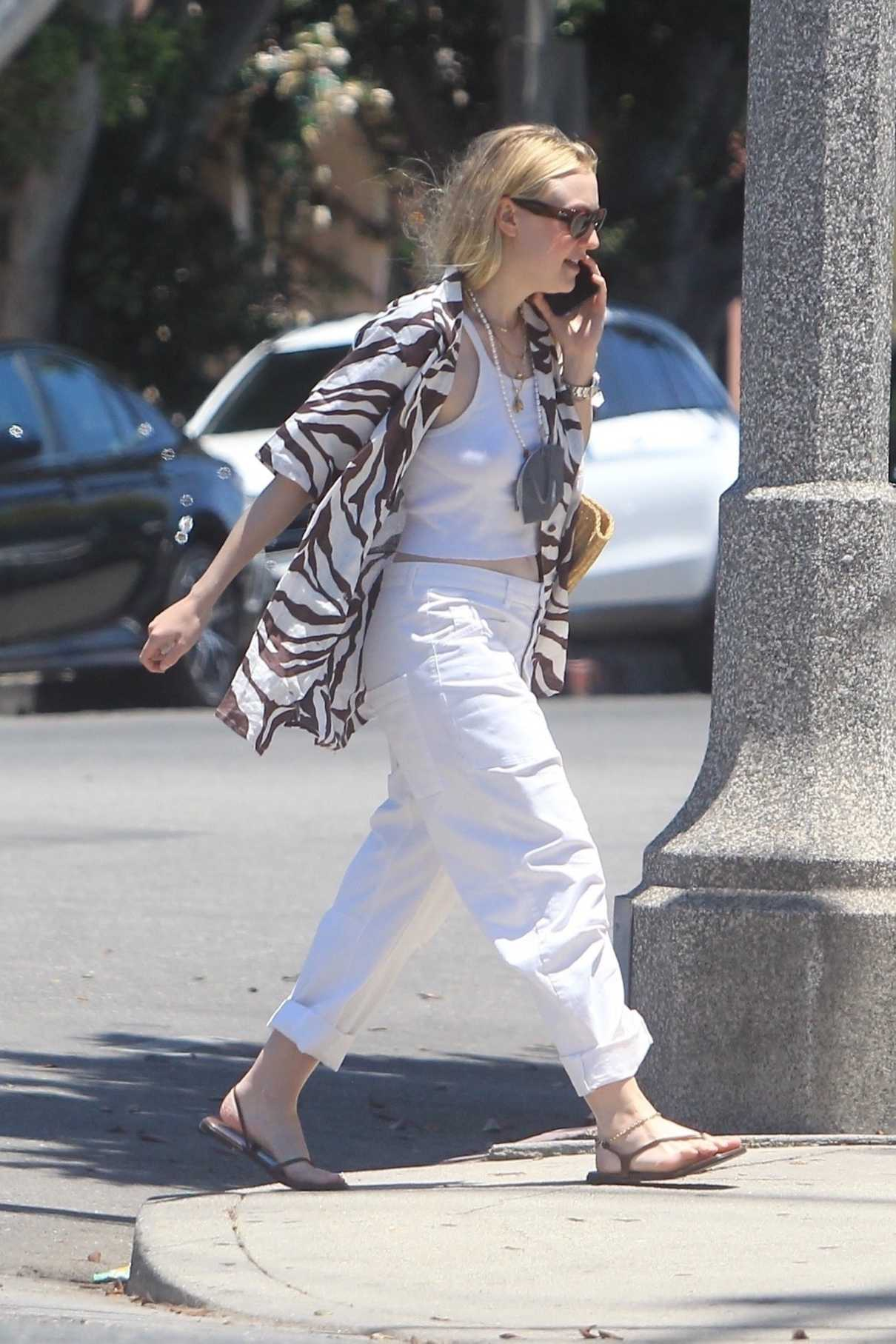 Dakota Fanning in a White Pants