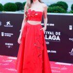 Ester Exposito in a Red Dress Attends 2021 Festival de Malaga at the Gran Hotel Miramar in Malaga 06/05/2021
