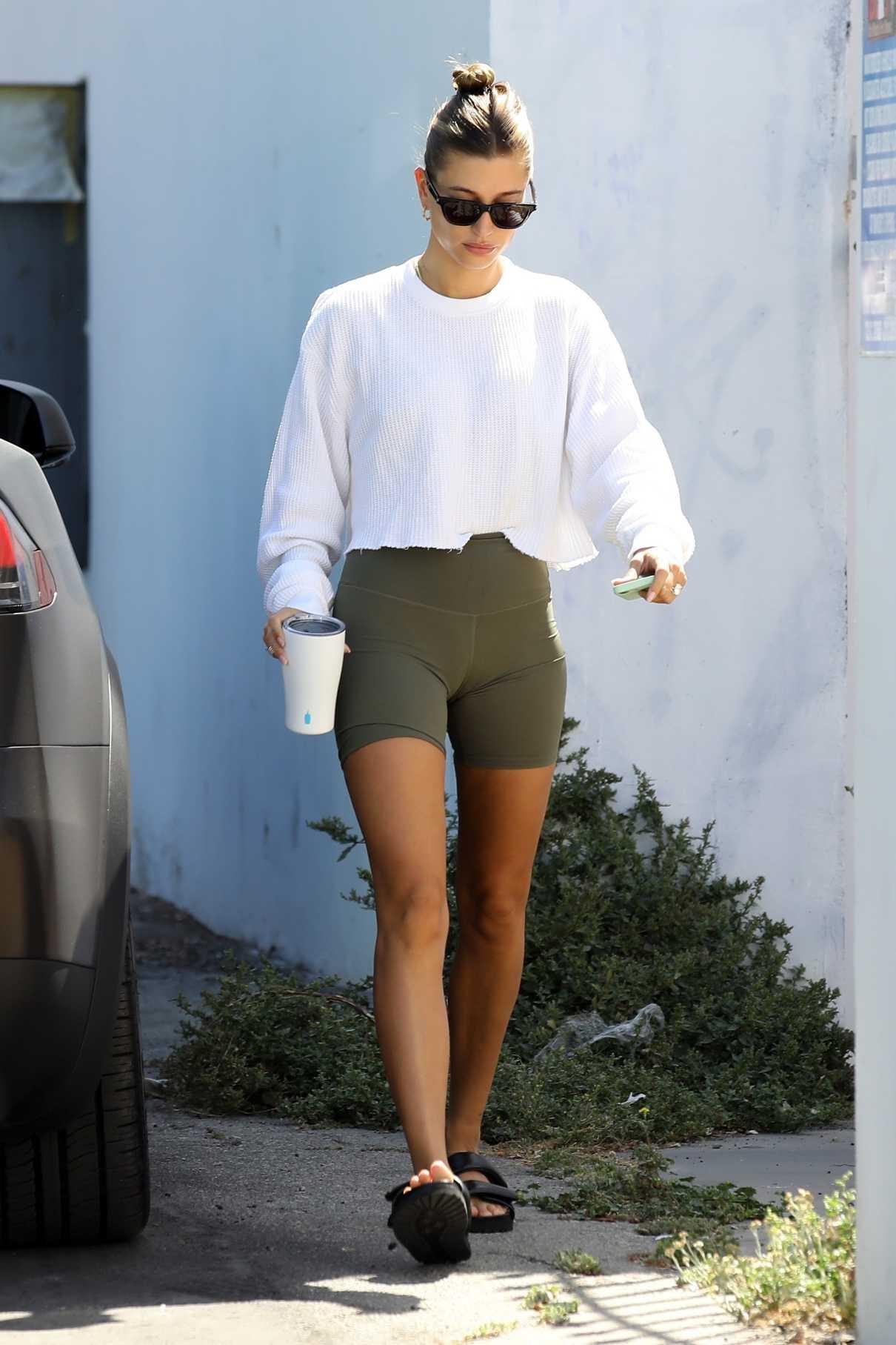 Hailey Bieber in a White Cropped Sweatshirt