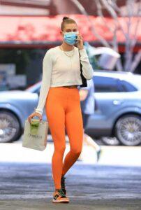 Hailey Bieber in an Orange Leggings