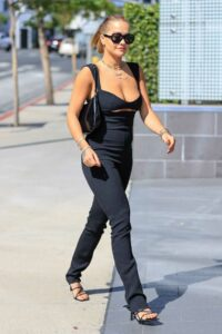 Rita Ora in a Black Low-Cut Jumpsuit