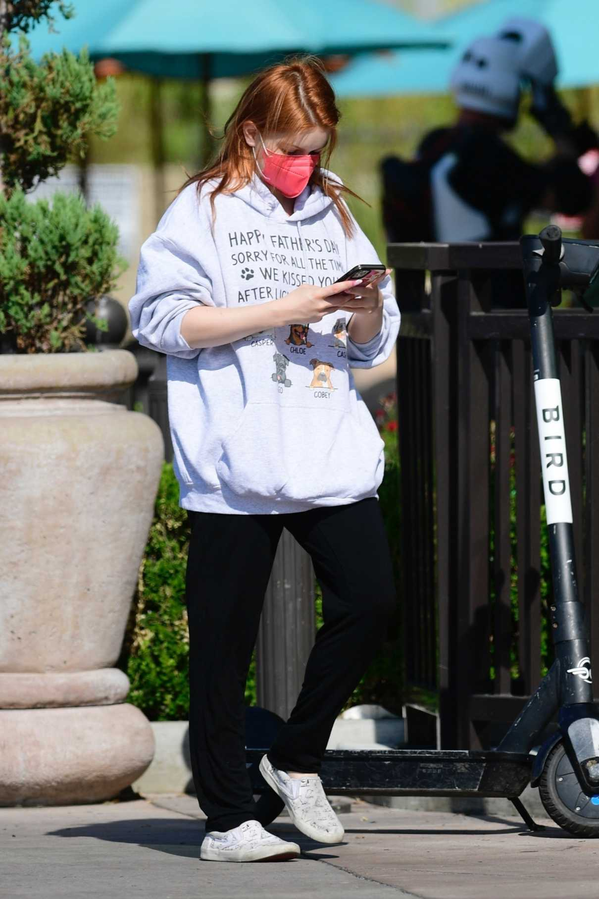 Ariel Winter in a Red Protective Mask