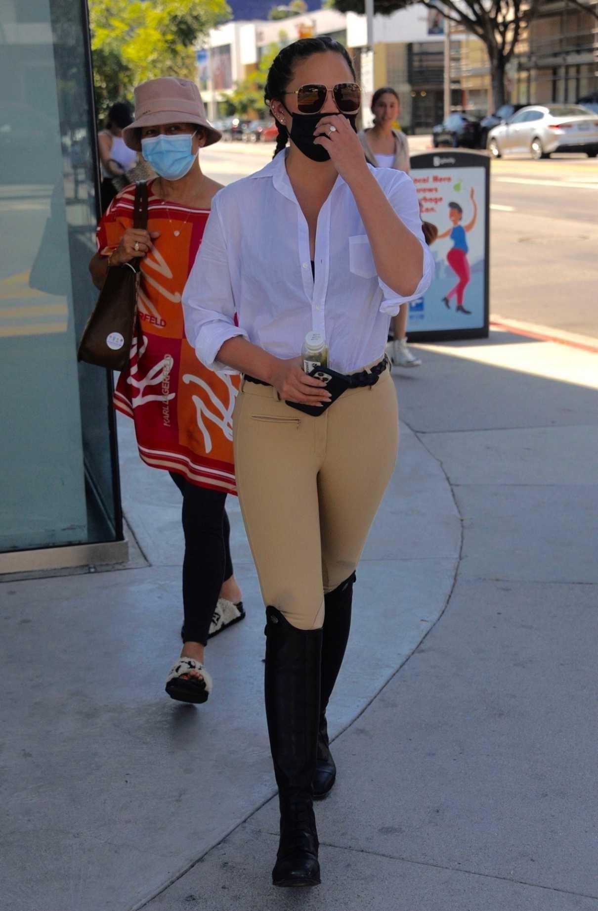 Chrissy Teigen in a White Shirt